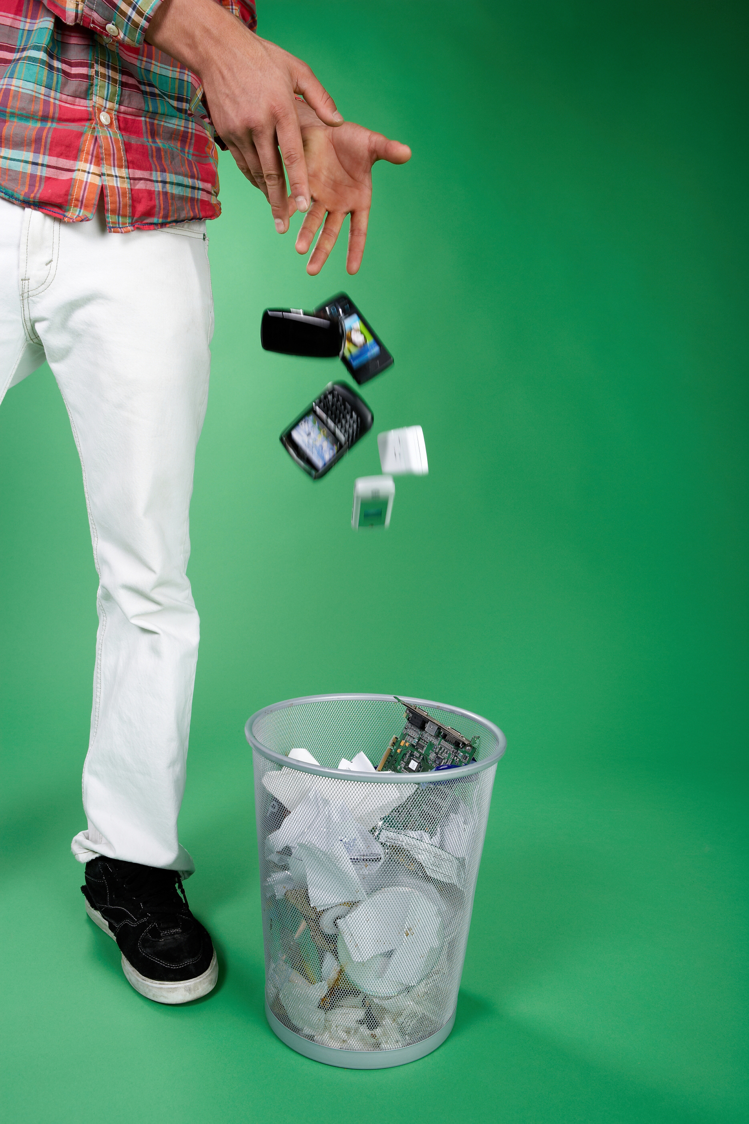 Phone and Electronics Tossed into Trashcan