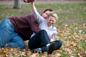 Couple Tackling Football