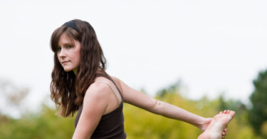 Girl Exercising In Field