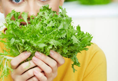 Woman Smelling Greens